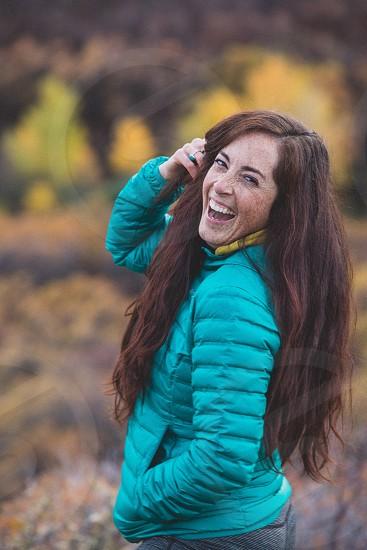 Fall joy freckles laugh outdoors down jacket woman model  photo