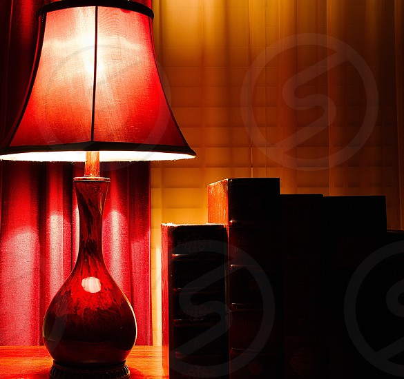 lamp next to books photo
