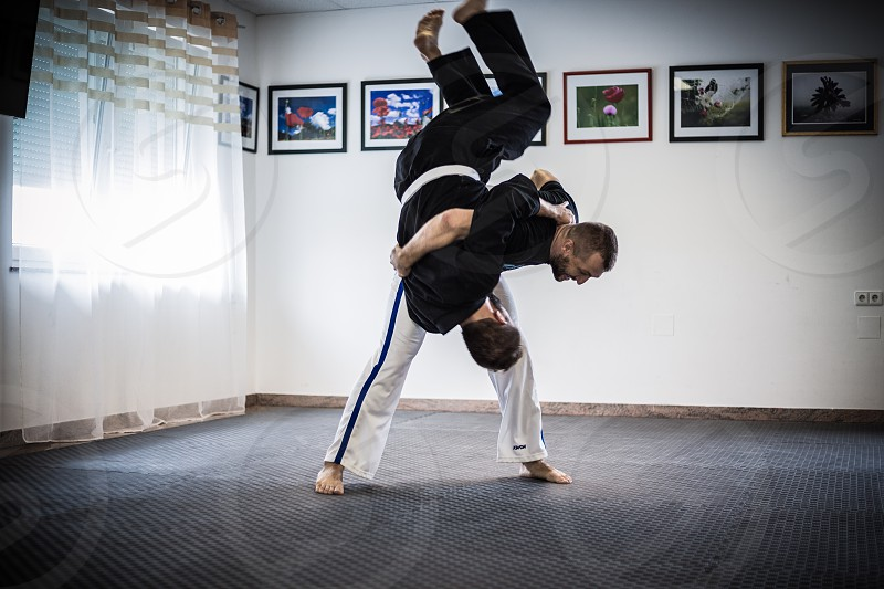2 person in karate gi forming grappling position photo