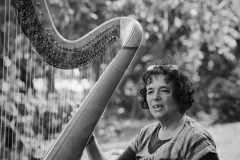 Woman playing harp in Central Park. photo