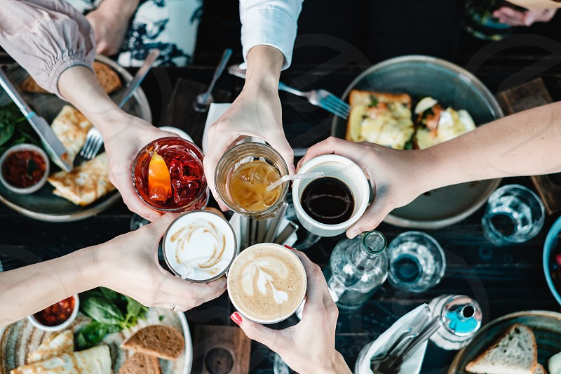 People toasting with different drinks top view photo
