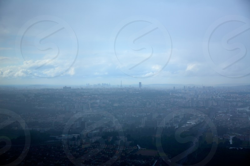 Paris aerial view on foggy day with Eiffel tower at background photo