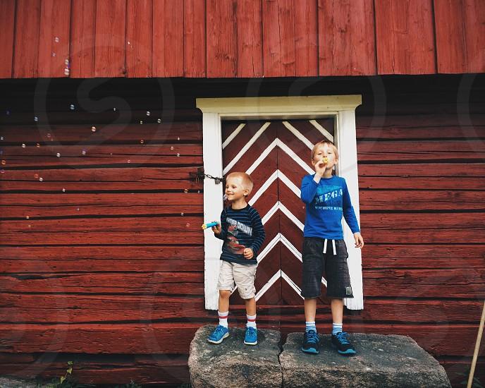 boys wearing long sleeve t-shirts and shorts photo