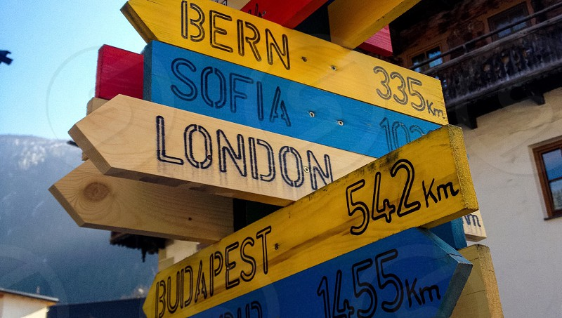 street signage showing bern at 335 km sofia at 102 km and budapest at 542 km photo