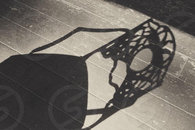 Porch chair shadow photo
