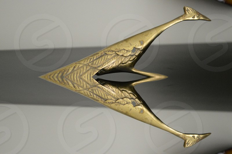 gold tone v-shape car emblem photo