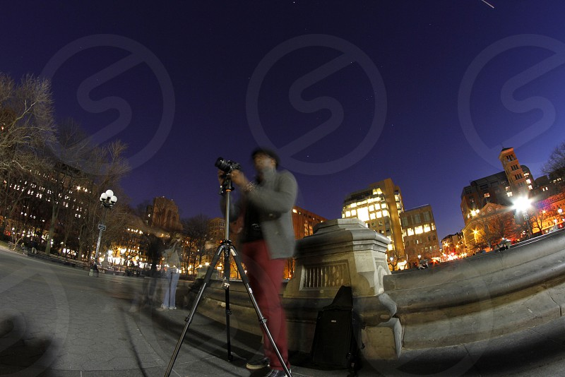 A photographer at work trying to capture the NYC skyline. photo