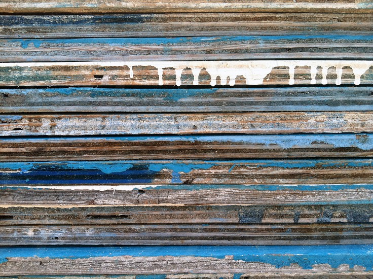plywood wood driftwood weathered beach ocean sea salty summer blue indigo painting art abstract fire island pines drips background stack photo