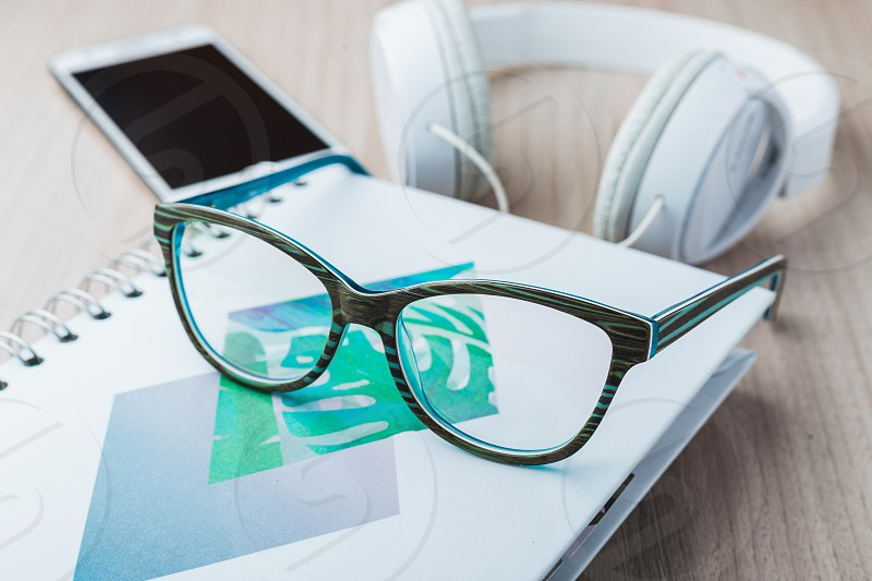 Woman glasses with phone and headphones photo