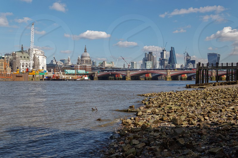 LONDON/UK - MARCH 21 : View down the Thames to the City of London on March 21 2018. Five Unidentified People. photo