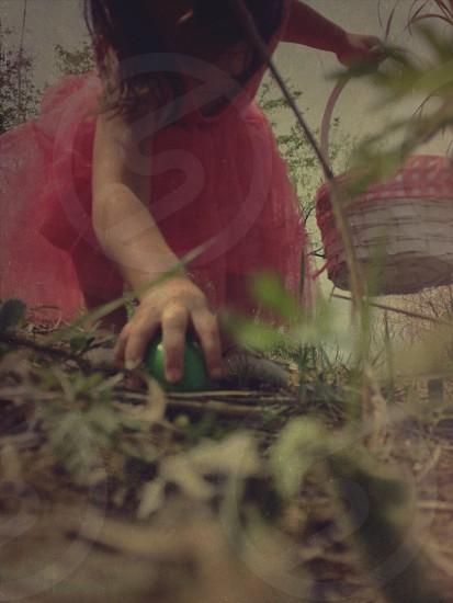 girl in tutu hunting for easter eggs photo