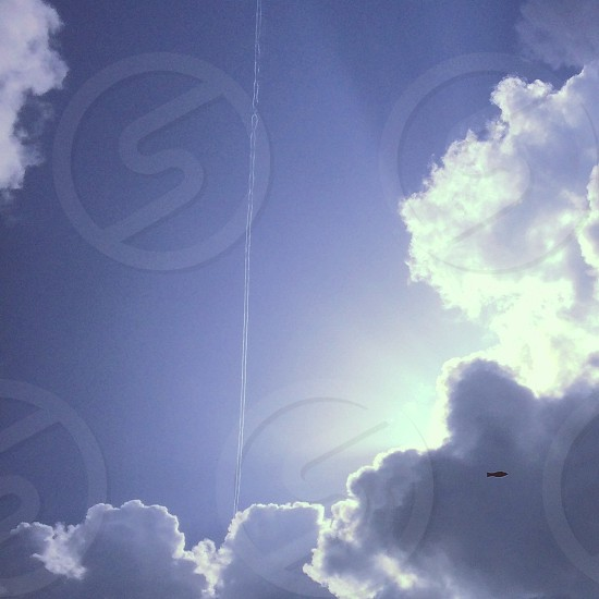 Plane trails clouds sunshine and a flying fish photo