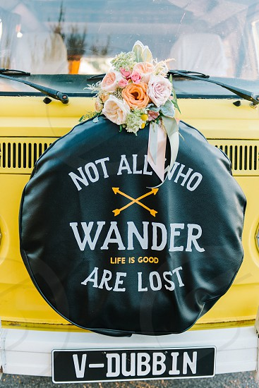 not all who wonder are lost quote vw bus yellow bus flowers bouquet colorful wedding wedding flowers photo