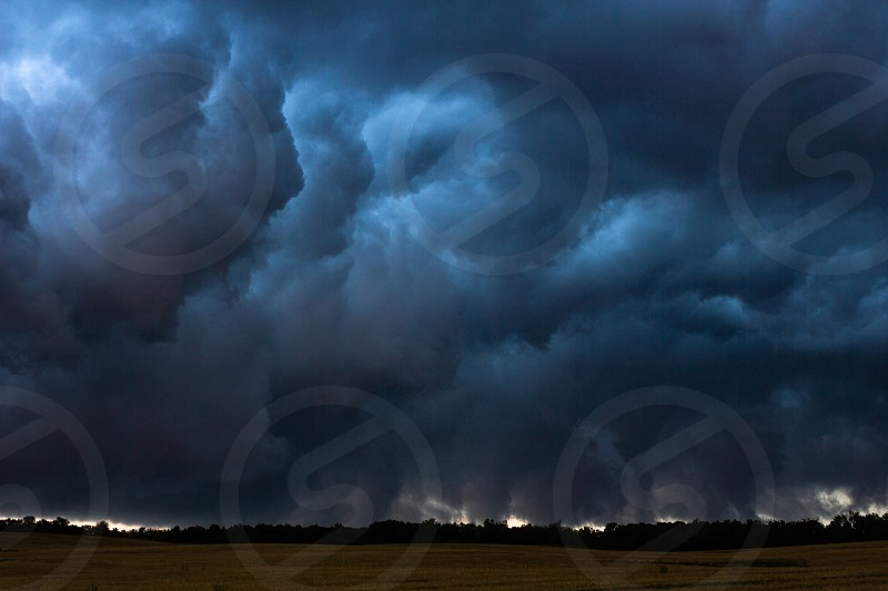 Dark heavy clouds in sky storm thunderstorm photo