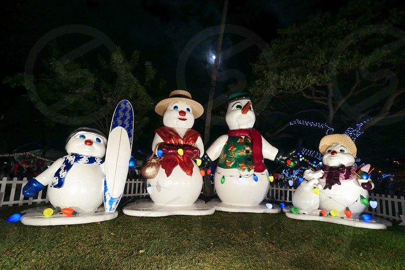 Snow man family Christmas decoration in Honolulu city lights show Hawaii  photo