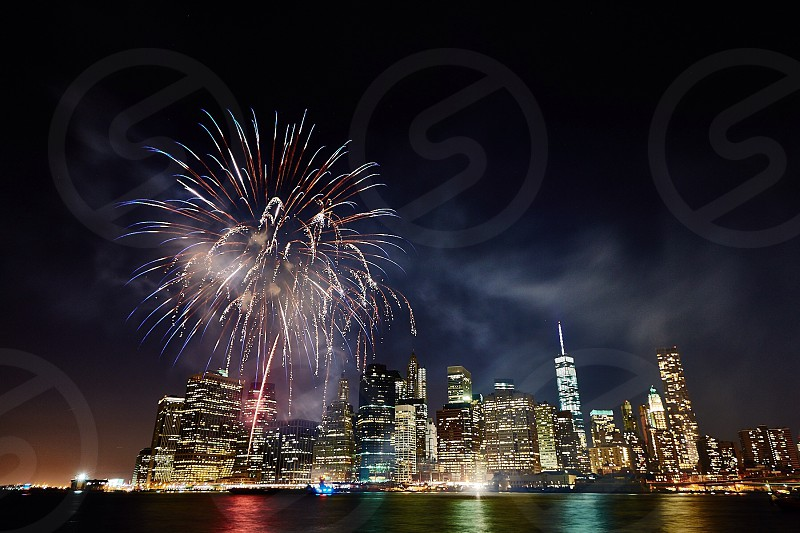 a fireworks display on the big city photo