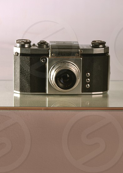 black and silver camera on glass top photo