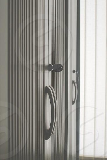 white door with key on keyhole photo