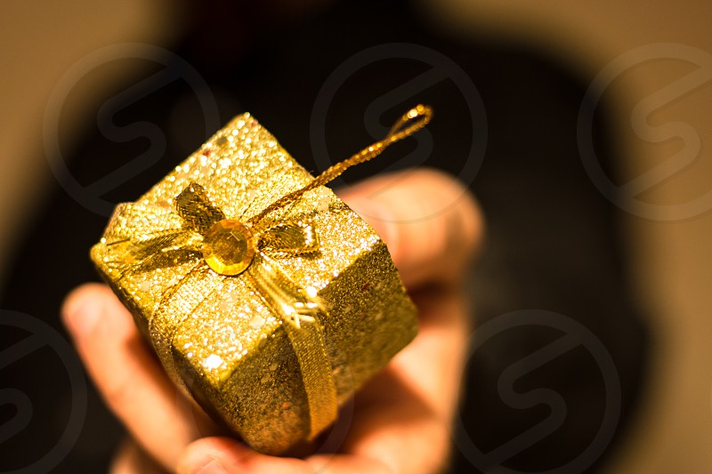 Man Giving Golden Gift photo