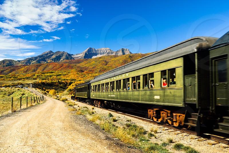 green and grey train photo