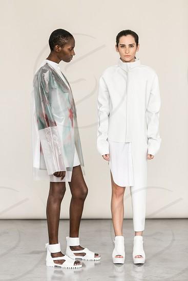 two women standing photo