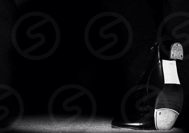 grayscale photo of leather dress shoes photo