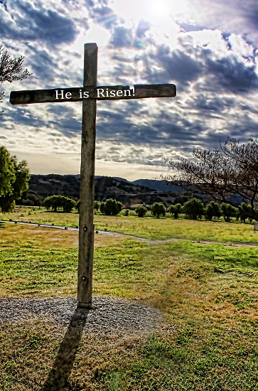 """Wooden cross with the words """"He is Risen"""" photo"""