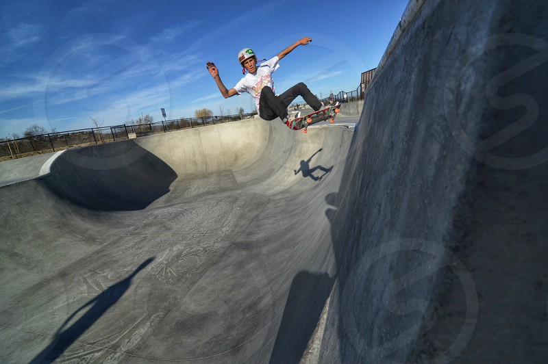 person skateboarding in skate park photo