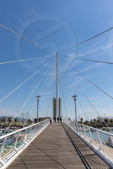 LA SPEZIA LIGURIA/ITALY  - APRIL 19 : View of the pedestrian bridge in La Spezia Liguria Italy on April 19 2019. Unidentifird people photo
