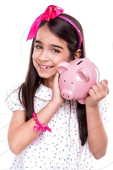 girl child kid pink money saving piggy bank isolated white background photo