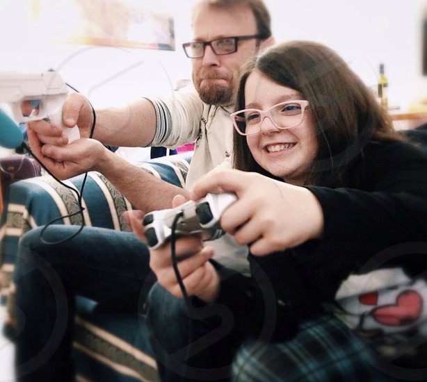 man and girl playing game photo