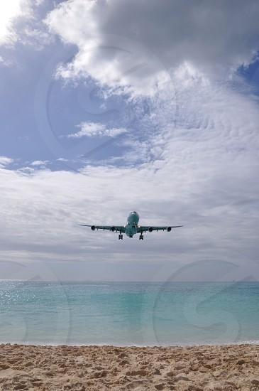 Jet coming in for landing over Maho Beach St. Maarten.  photo