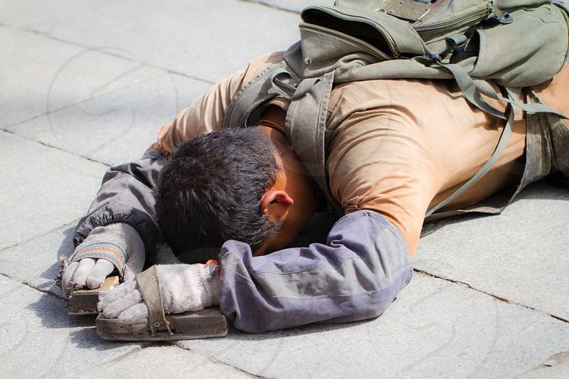 Man Prostrate Prayer Tibet China photo