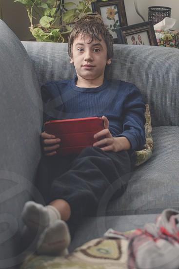 thirteen year old on ipad photo