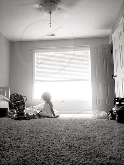 girl sitting on the floor photo