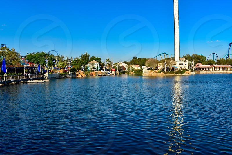 Orlando Florida. March 09 2019. Colorful Waterfront Sky Tower and blue lagoon at Seaworld in International Drive area (1) photo