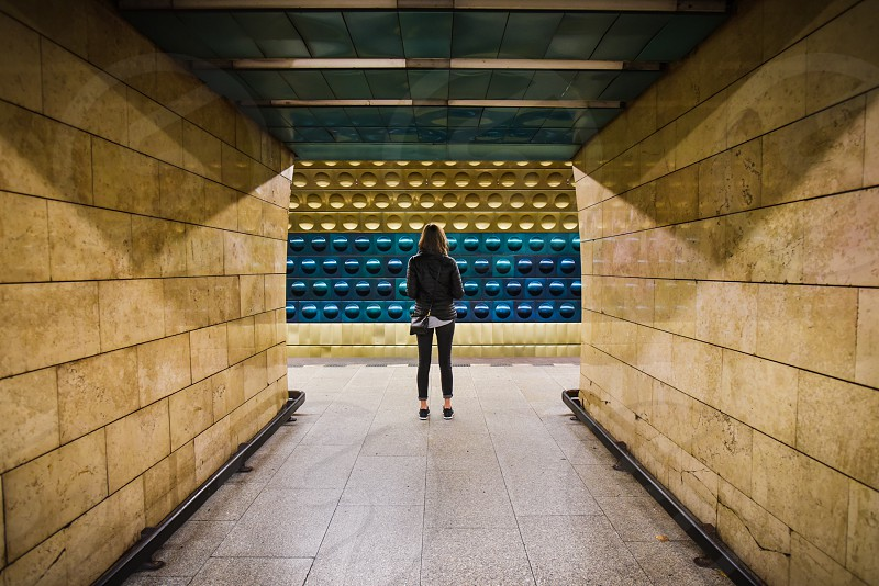 subway train waiting woman alone underground geometry  photo