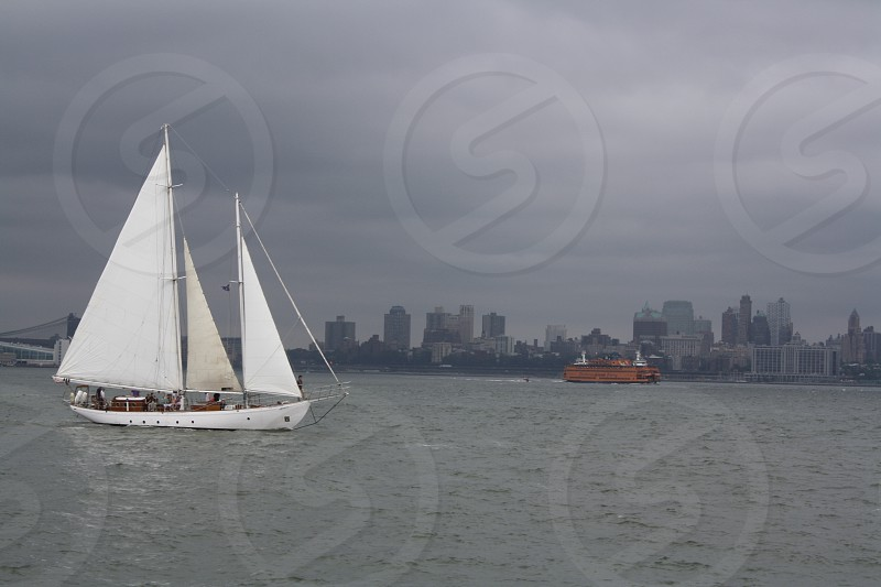 Sailboat on a cloudy day photo