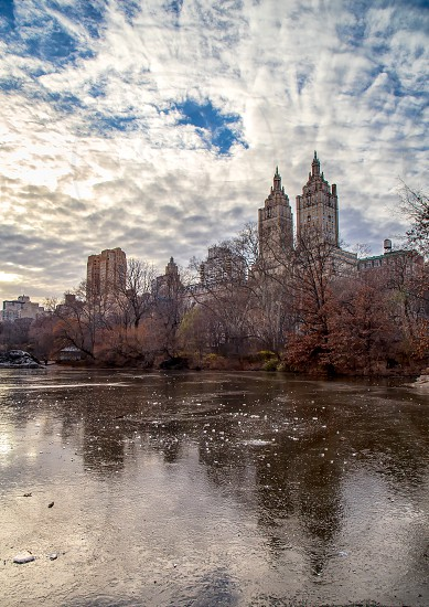 Dramatic sky over frozen Central Park Pond and New York Skyline. photo