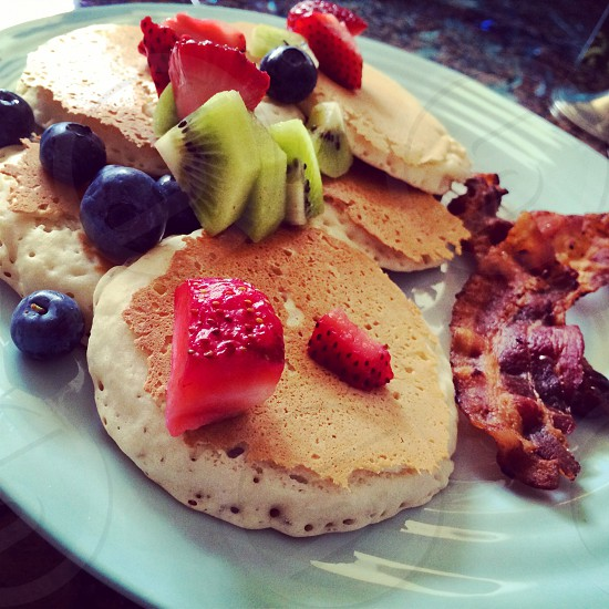 Pancake Fresh Fruit Topping served with Extra Crispy Bacon for brunch  photo