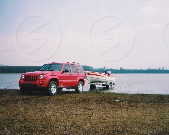 Jeep preparing boat to adventure in open lake.  photo