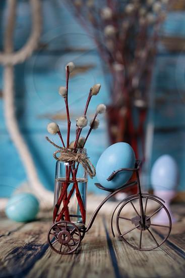 Easter color eggs vase bouquet willow decoration  photo