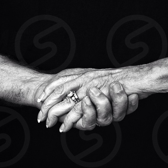 two people holding each other hands photo