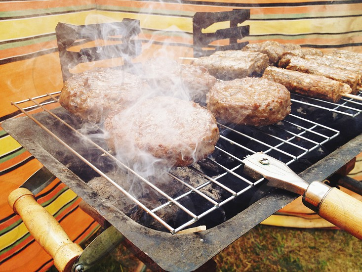 hamburger patties on barbecue grill photo