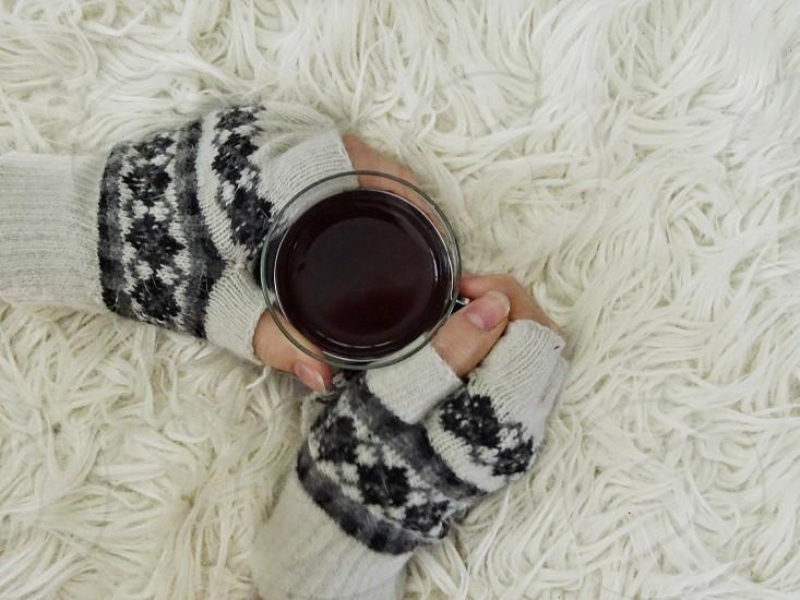 mittens hot drink tea decoration drink furry furry background fingershands gloves wintertime winter season relaxing enjoy  photo