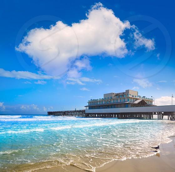 Daytona Beach in Florida with pier and coastline USA photo