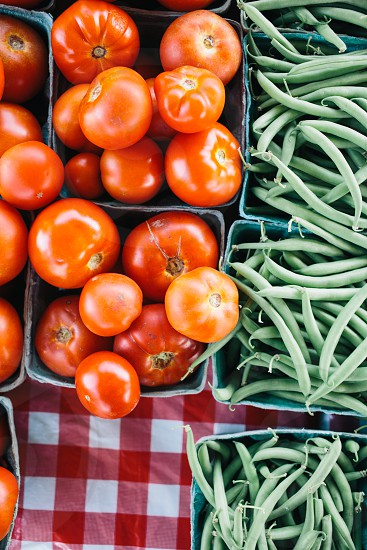 red tomatoes beside green beans photo