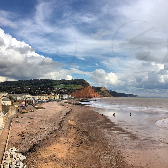 Devon Beach Sand Sea Red Cliffs South Coast England Sidmouth Fluffy Clouds Blue Sky photo