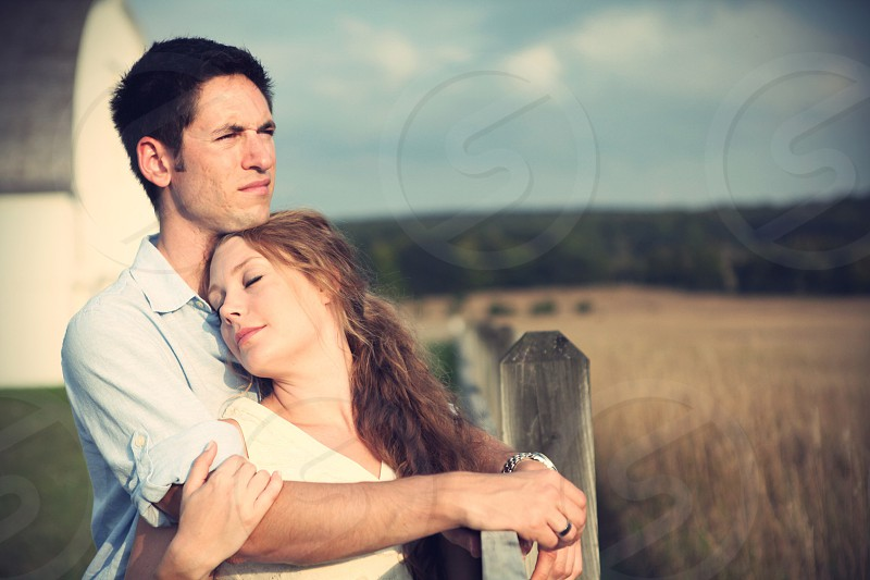 man hugging woman photo