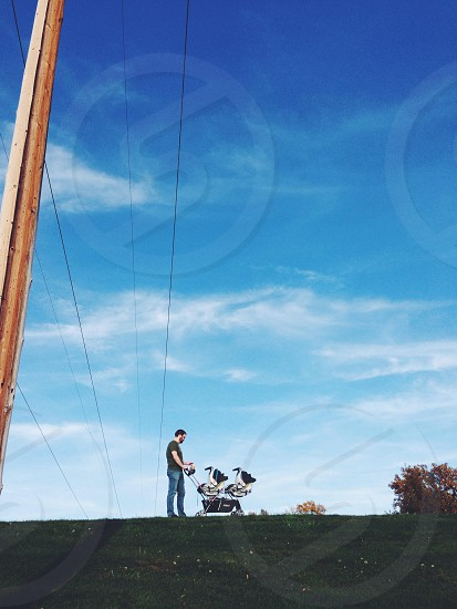 Adventure dad stroller twins walk park negative space photo